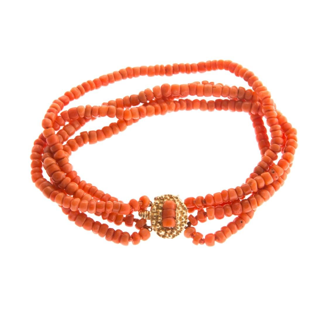 A Lady's Four Strand Coral Bracelet & Gold Clasp