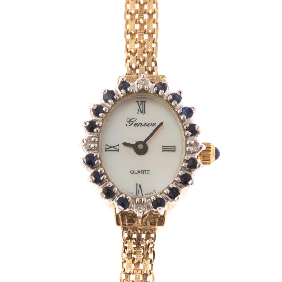 A Lady's 14K Geneve Dress Watch with Sapphires