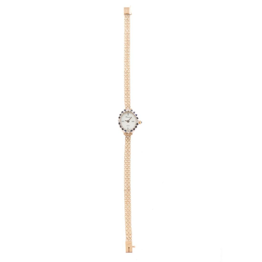 A Lady's 14K Geneve Dress Watch with Sapphires - 2