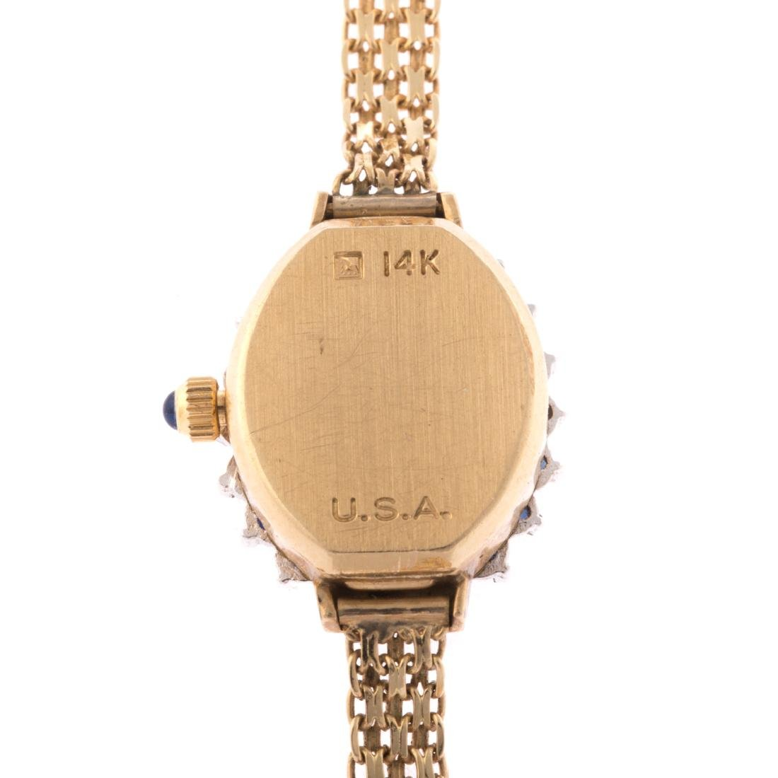 A Lady's 14K Geneve Dress Watch with Sapphires - 3