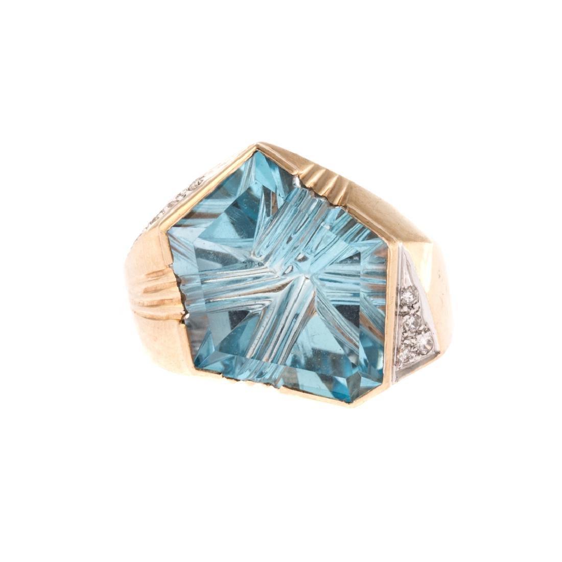 A Lady's Contemporary Blue Topaz & Diamond Ring