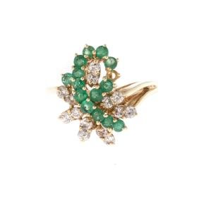 A Lady's Emerald and Diamond Cocktail Ring