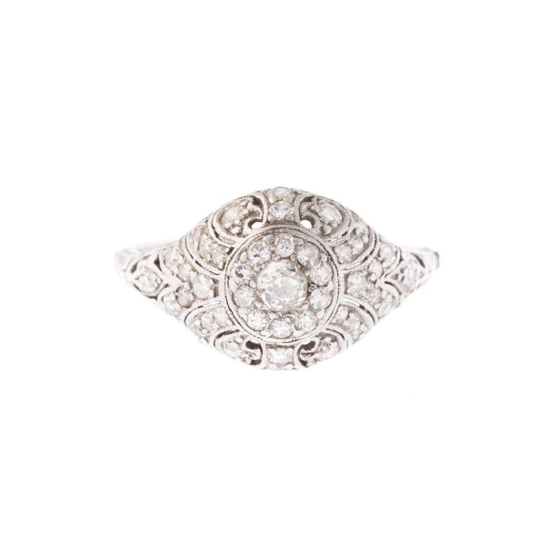 A Lady's Platinum Diamond Filigree Ring