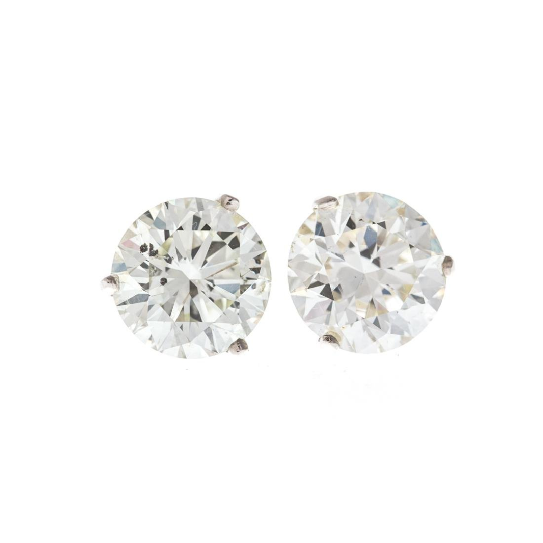 A Pair of Diamond Solitaire Earrings 4.45 Cts