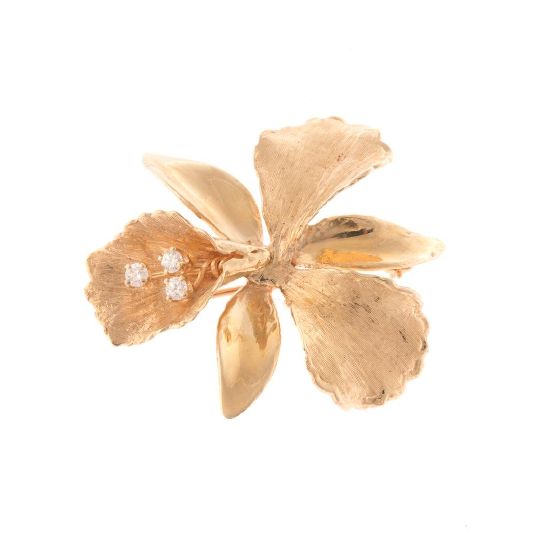A Lady's Orchid Brooch with Diamonds in 14K Gold