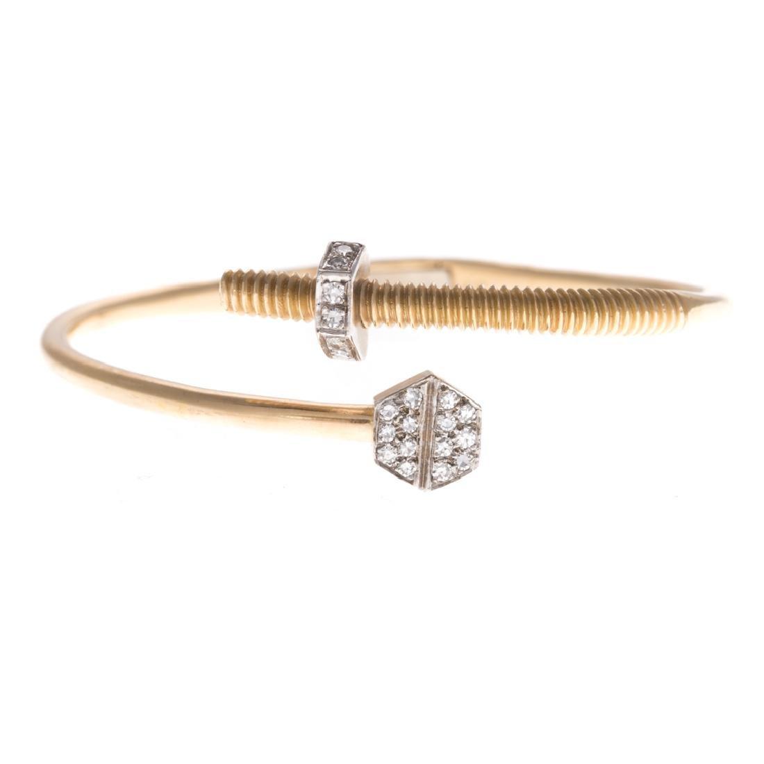 A Gold and Diamond Nail & Screw Cuff Bracelet