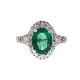 A Lady's Emerald and Diamond Ring in White Gold