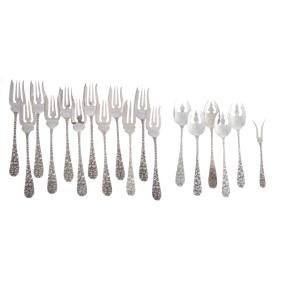 A collection of Schofield sterling silver forks