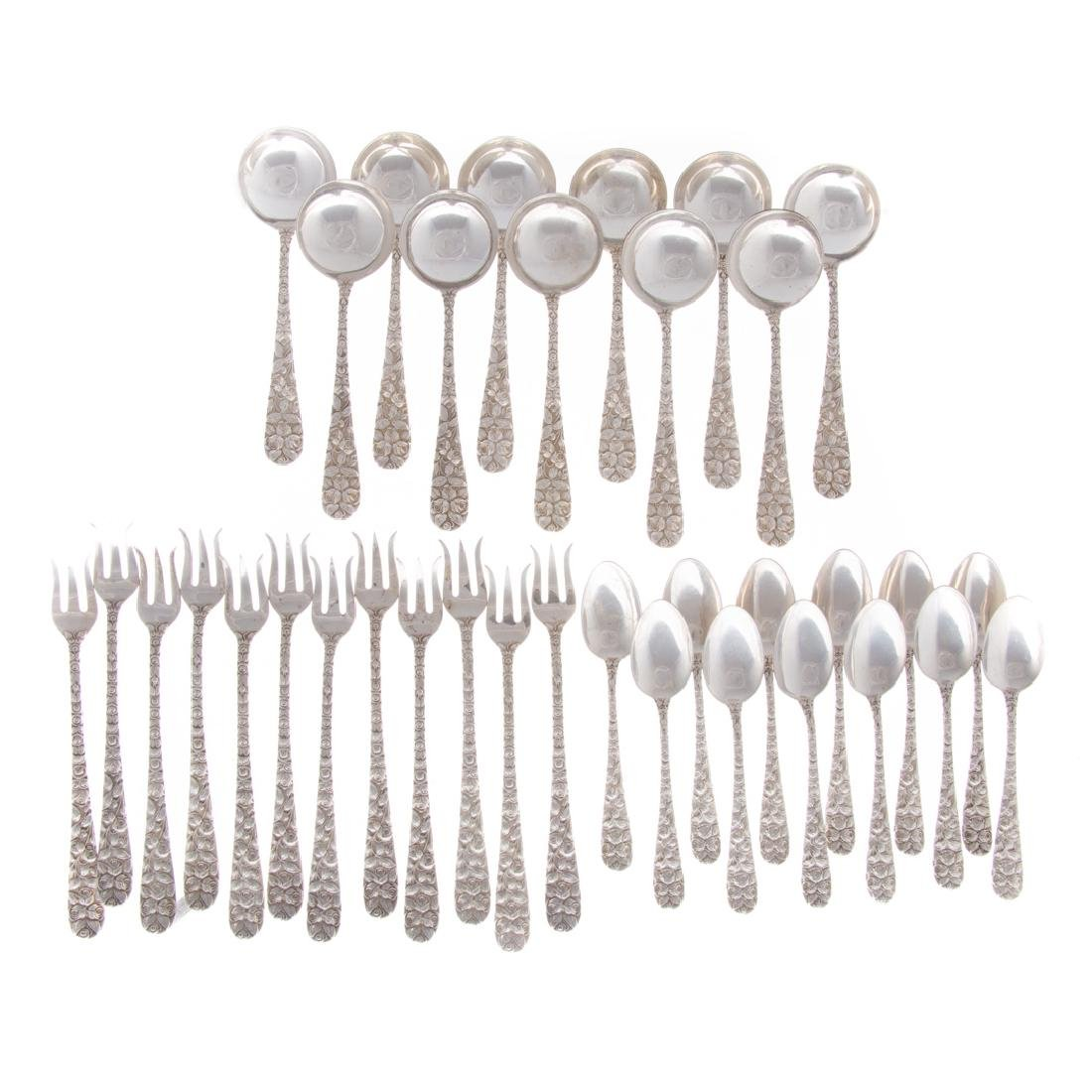 Hand Chased Rose sterling flatware by Schofield