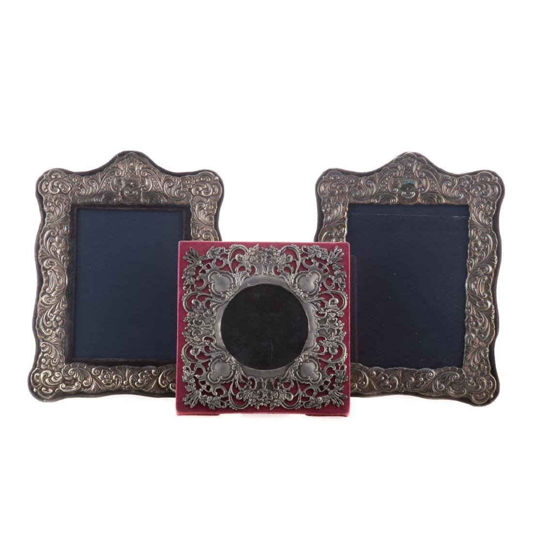 Pair of repousse sterling 5 x 7 picture frames