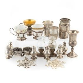 A collection of small sterling table items