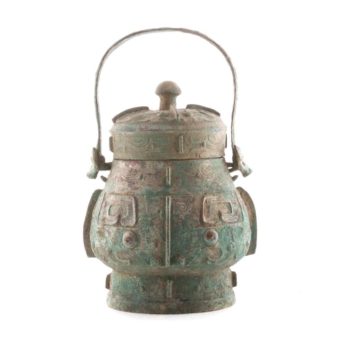 Chinese Chou style bronze vessel with handle