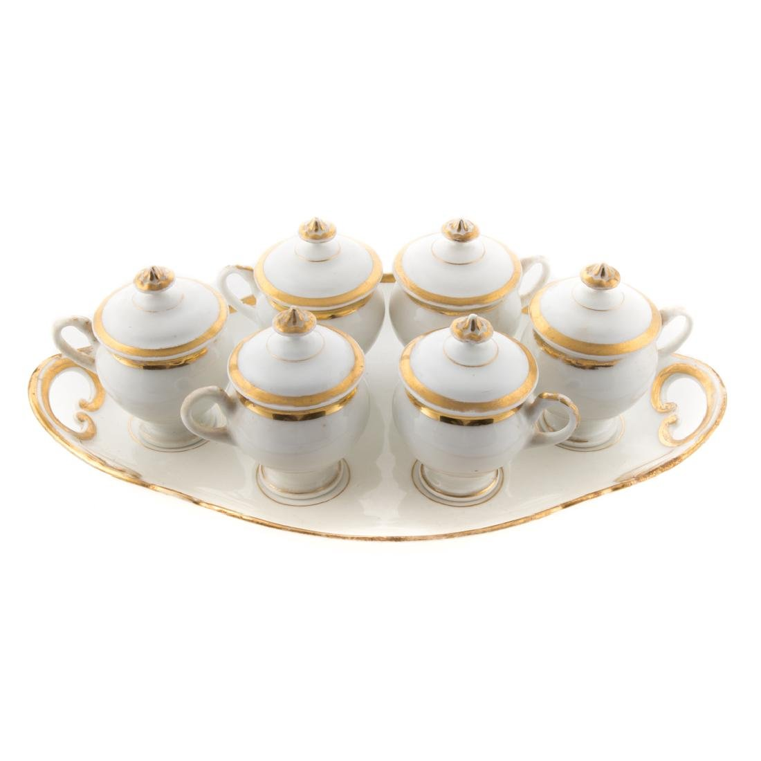 Six Porcelain de Paris syllabubs with fitted tray