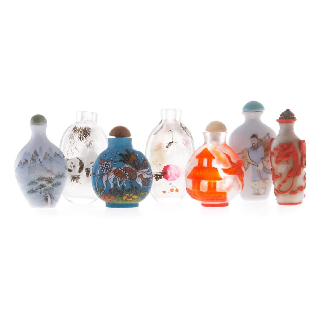 Seven Chinese glass and porcelain snuff bottles