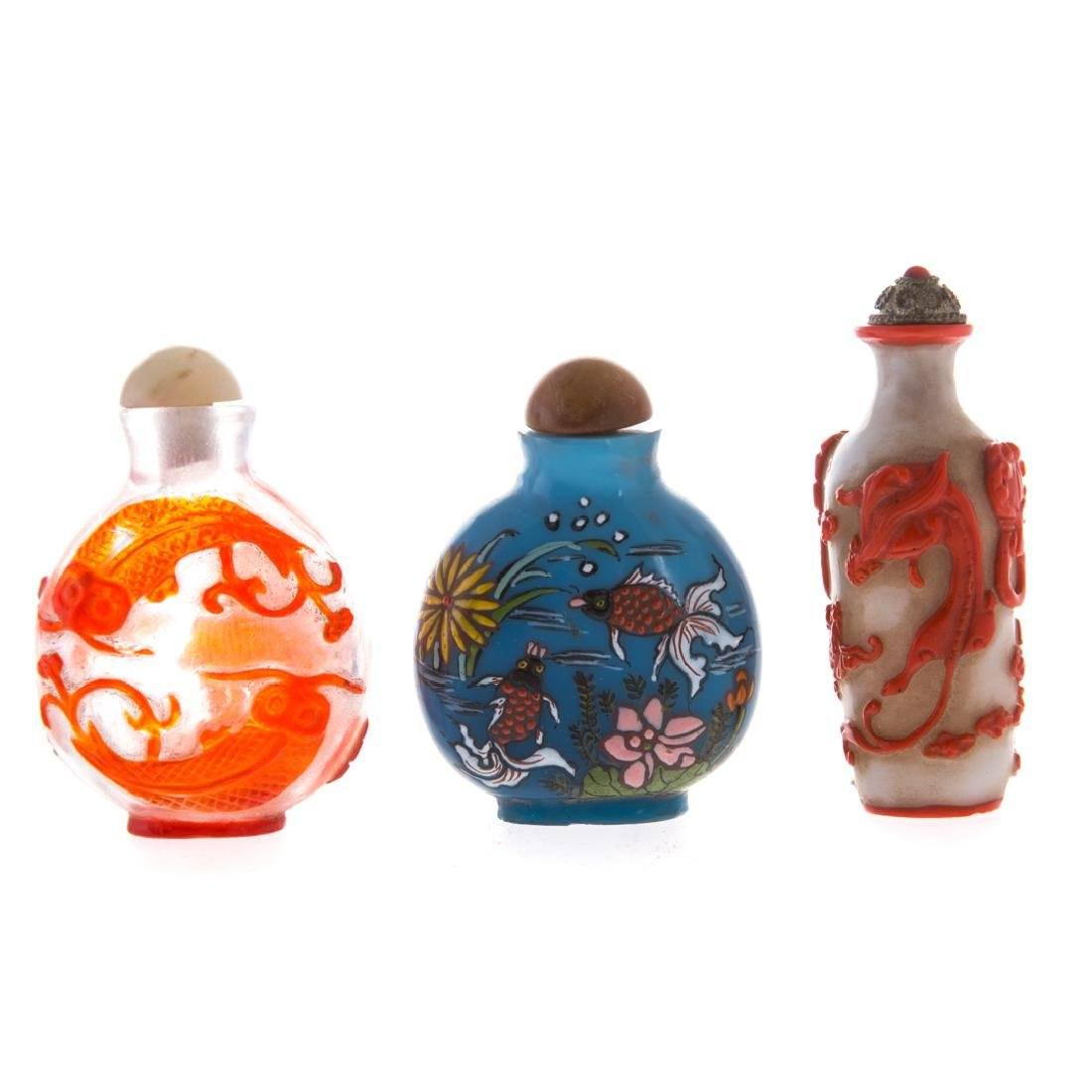 Seven Chinese glass and porcelain snuff bottles - 4
