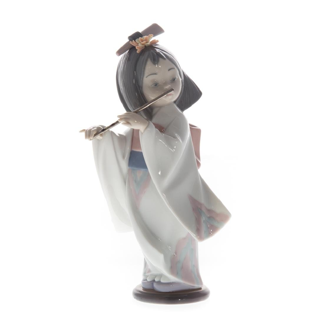Lladro porcelain figure: Playing the Flute