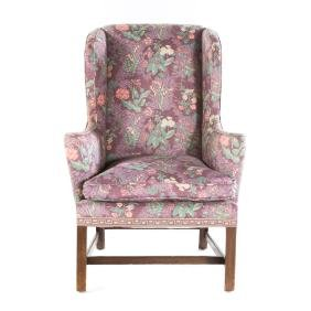 Chippendale style mahogany upholstered wing chair