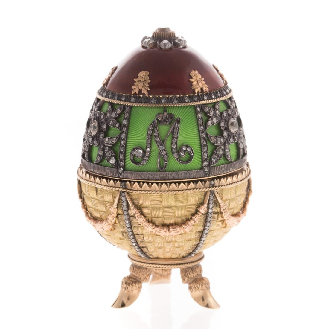 A Russian Enameled Gold Egg with Diamonds