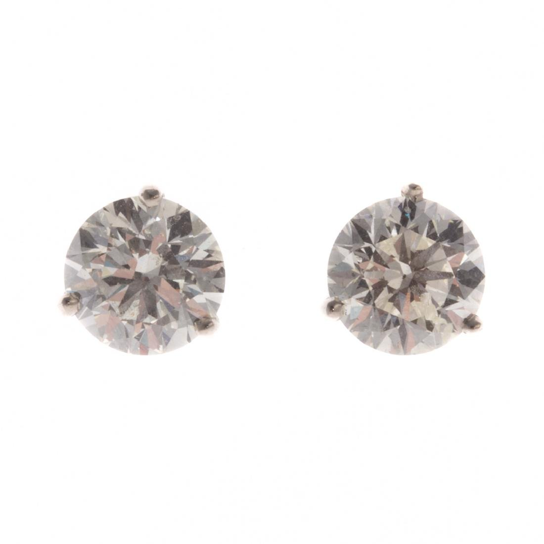 A Pair of Diamond Solitaire Earrings 4.0 Cts.