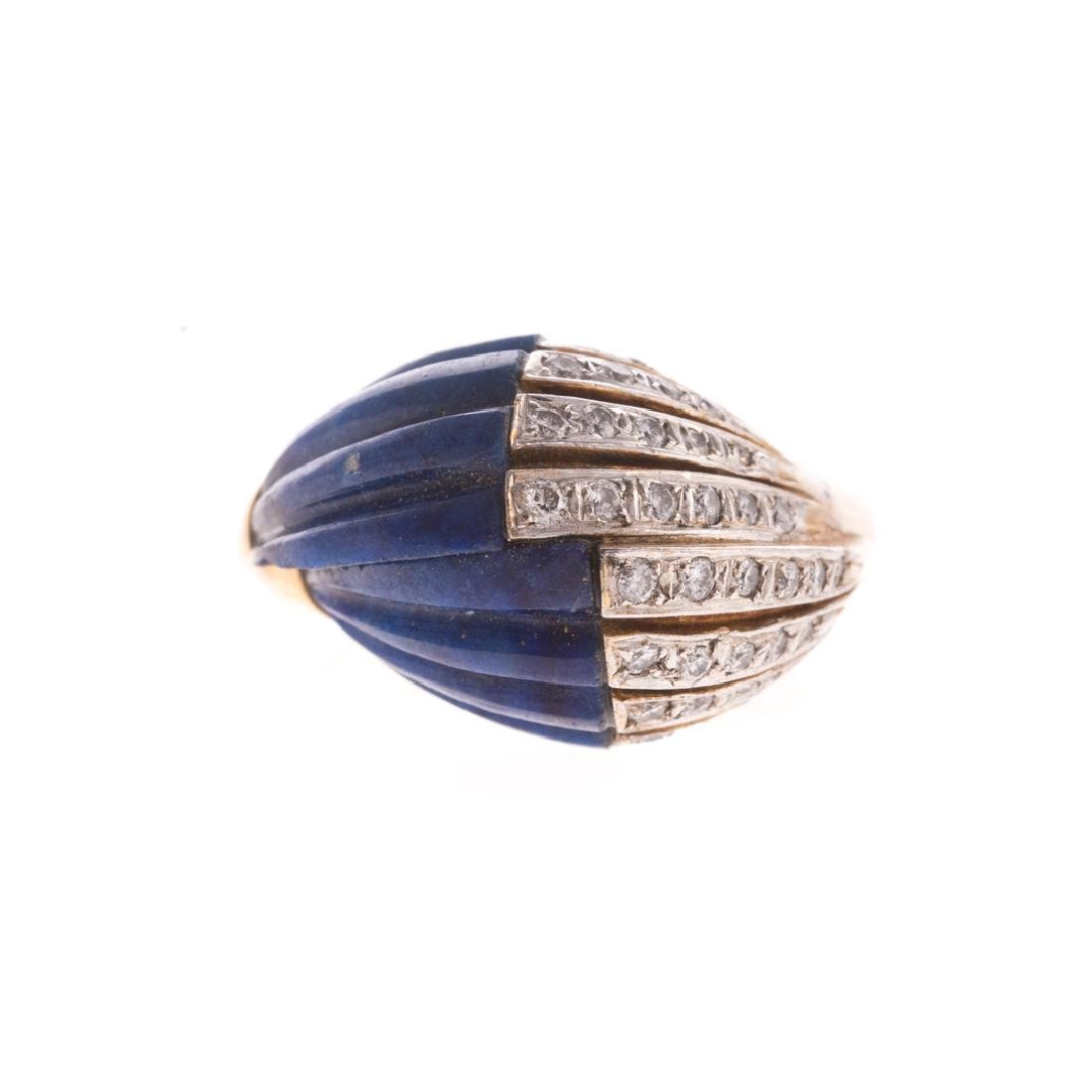 A Lady's Carved Lapis and Diamond Ring