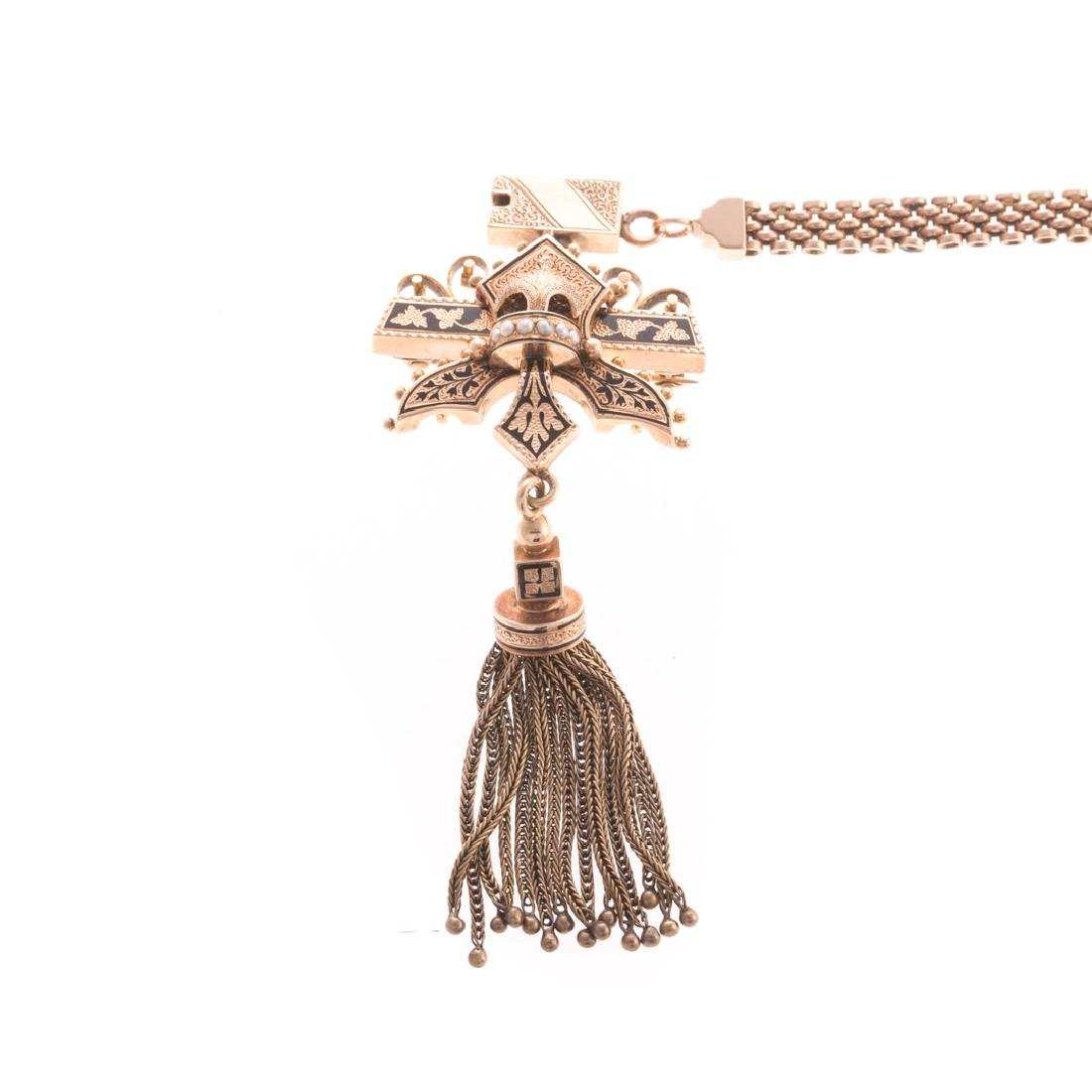 A Gold Chain with Victorian Slider Tassle Pendant