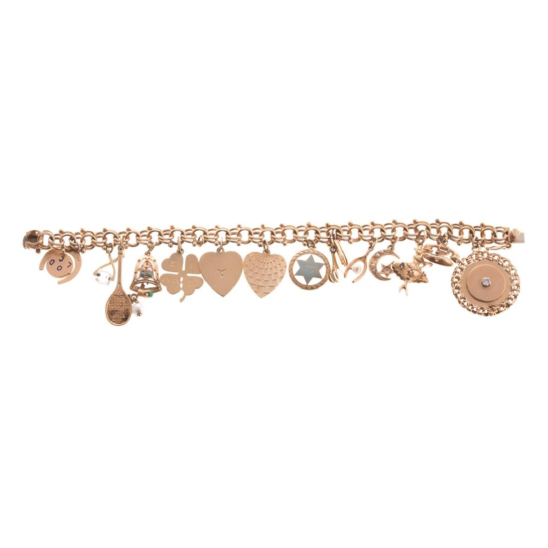 A Lady's Gold Link Bracelet with 15 Charms
