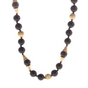 A Lady's Black Onyx and Gold Beaded Necklace