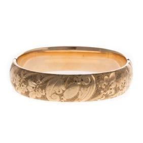 A Wide Floral Bangle Bracelet in Gold
