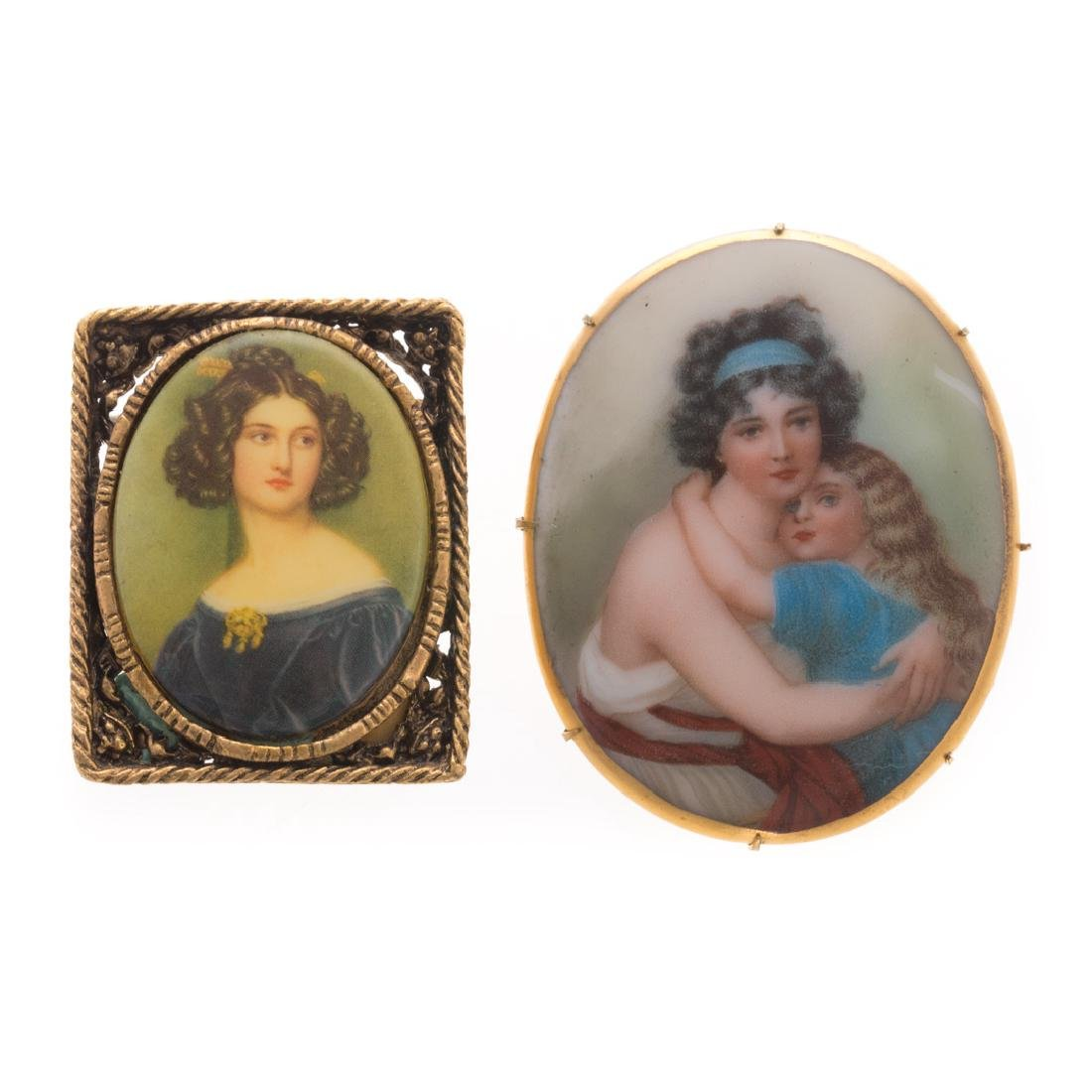 A Pair of Painted Porcelain Miniature Brooches