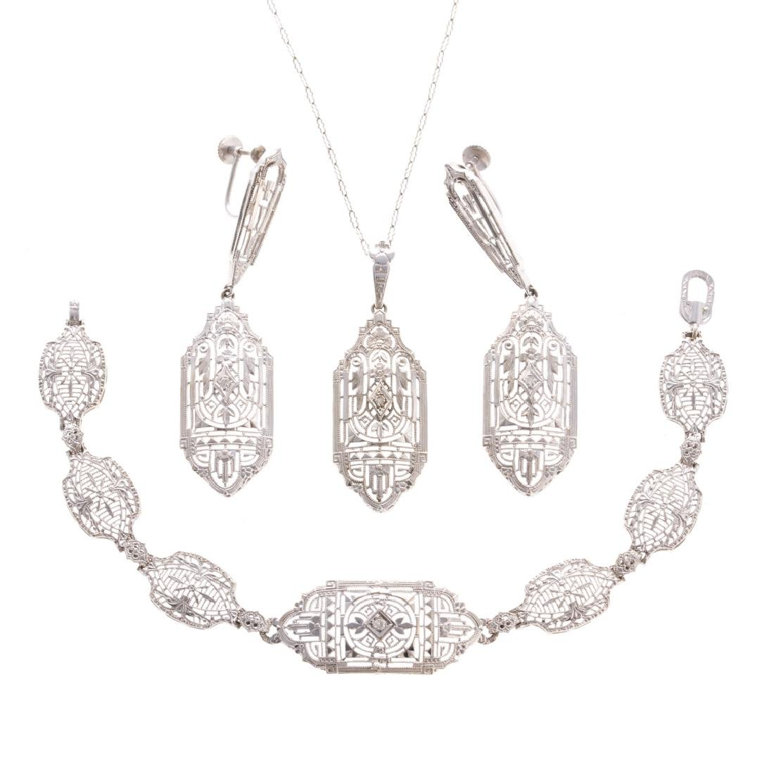 A Suite of Lady's 14K White Gold Filigree Jewelry