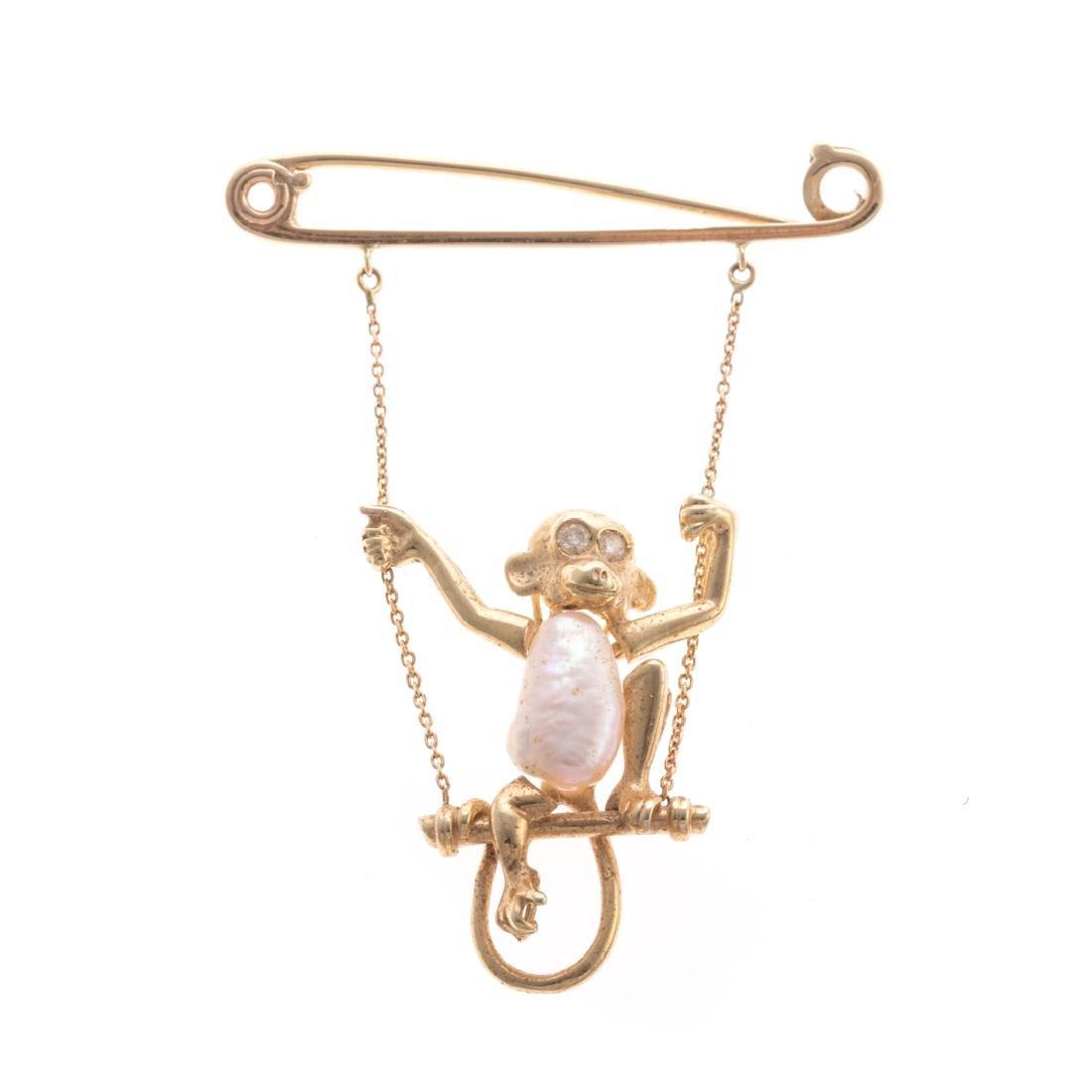 A Lady's 14K Pearl Monkey on a Swing Brooch