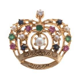 A Lady's Gemstone Encrusted Crown Brooch
