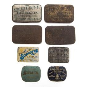 Eight phonograph needle tins