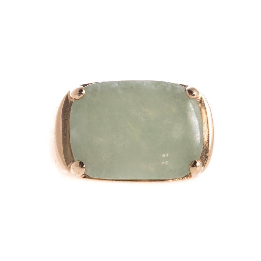 A Lady's Light Green Jade Ring in 14K Gold