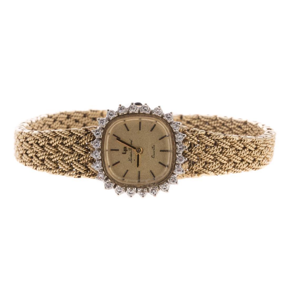 A Lady's Lucian Piccard 14K Gold & Diamond Watch