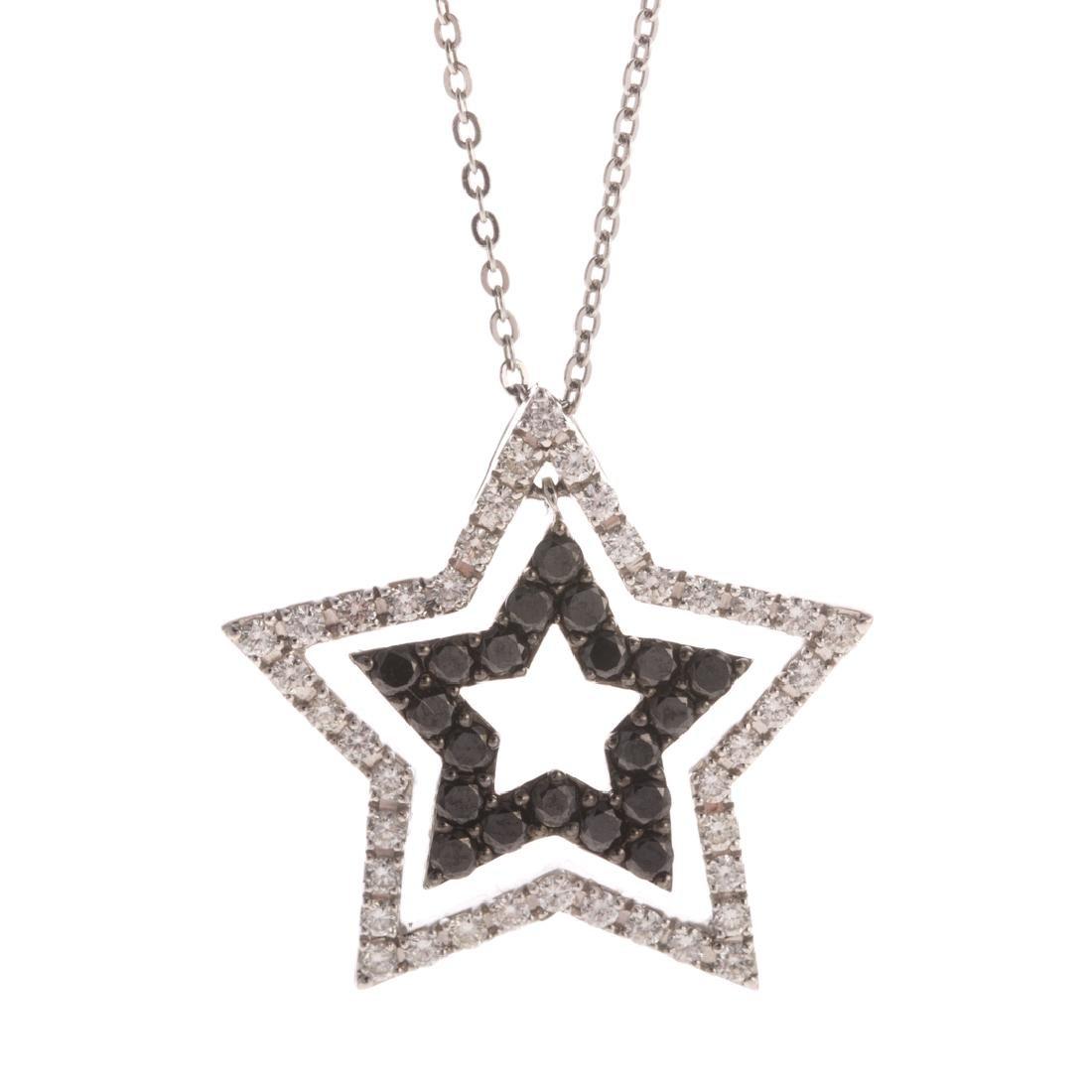 A Black & White Diamond Star Pendant