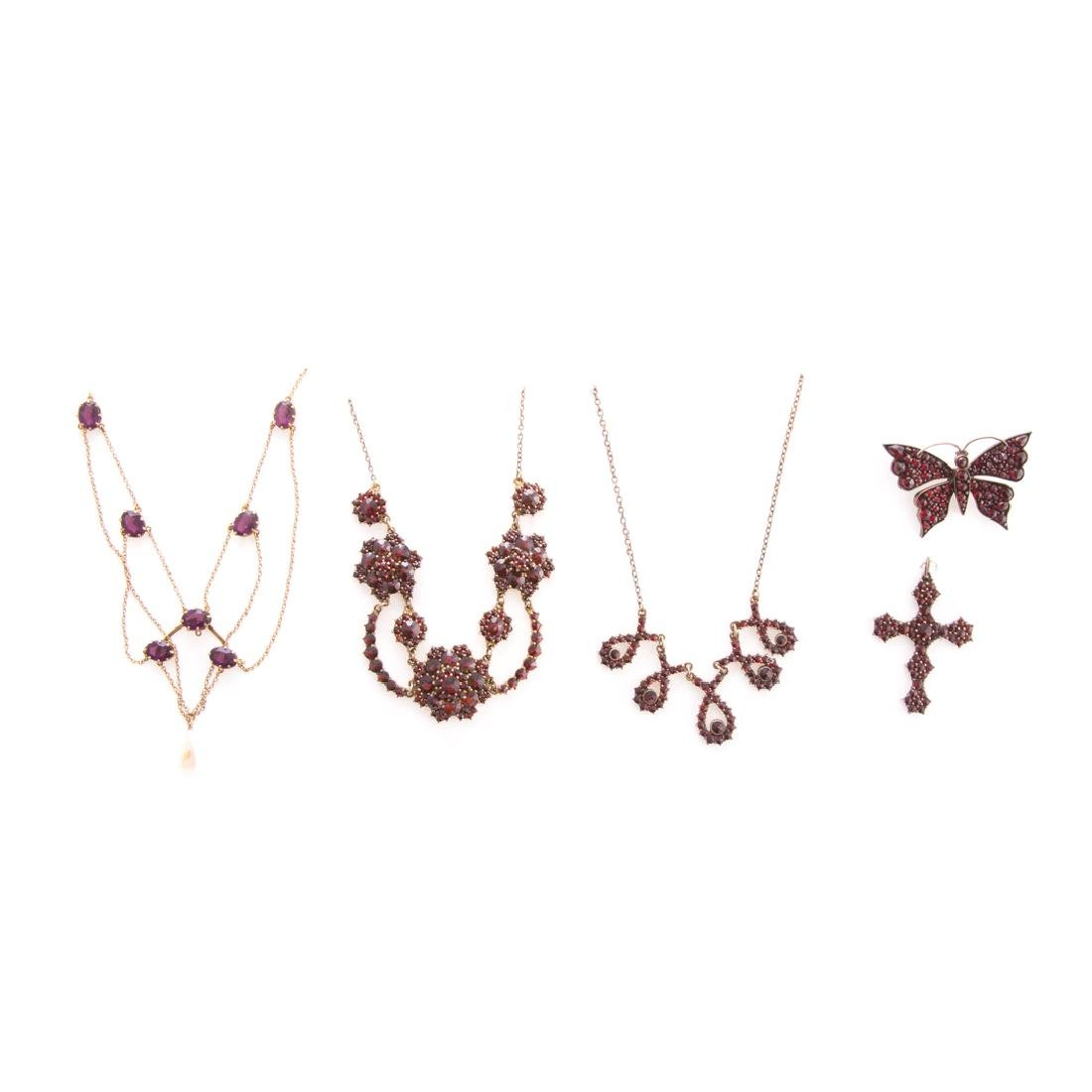 A Collection of Garnet & Amethyst Pins & Necklaces