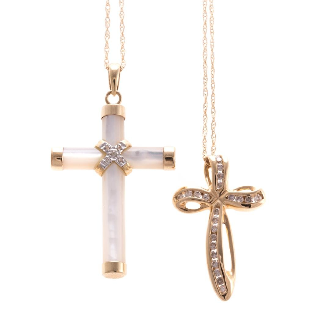 A Pair of Lady's Cross Pendant in Gold