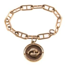 A Lady's Gold Pisces Charm And Link Bracelet