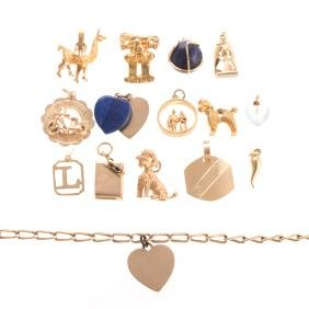 A Gold Charm Bracelet With 15 Gold Charms