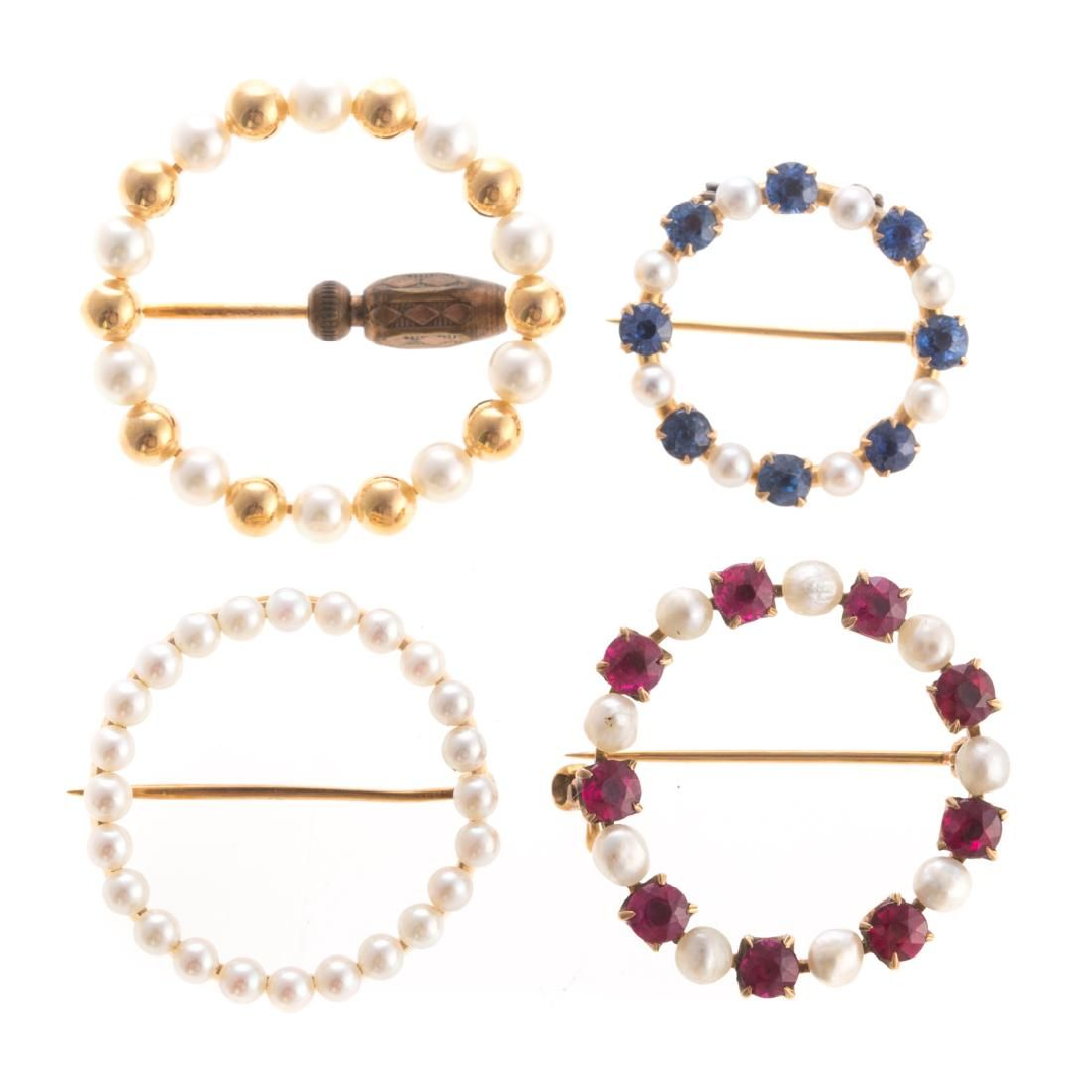 Four Circular Brooches in Pearls and Gold