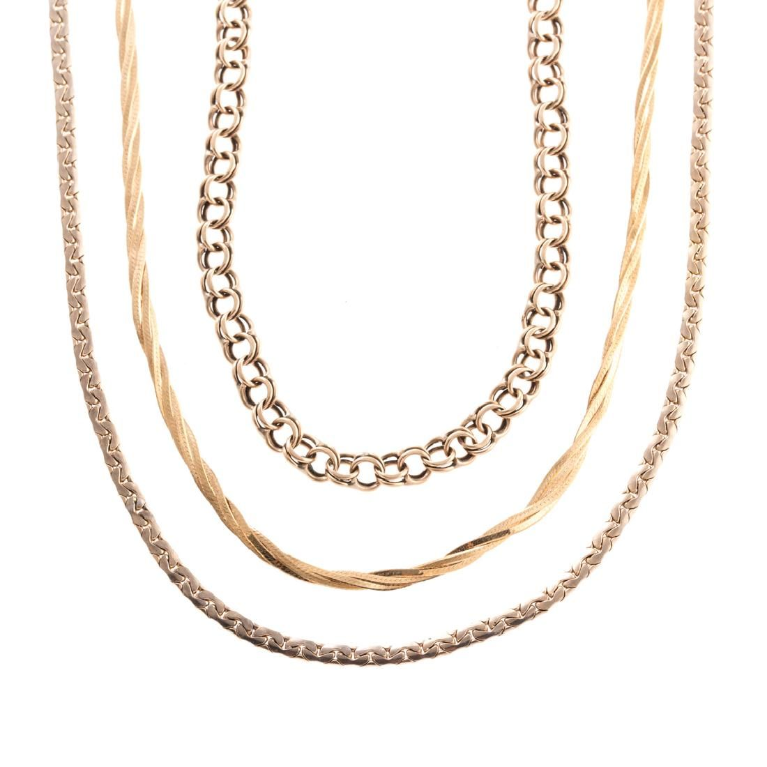 A Pair of Gold Chain Necklaces and Bracelet