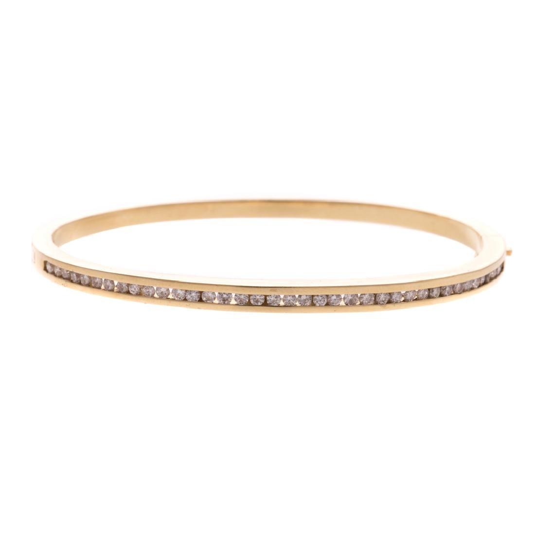A Lady's Diamond Bangle Bracelet in 14K Gold