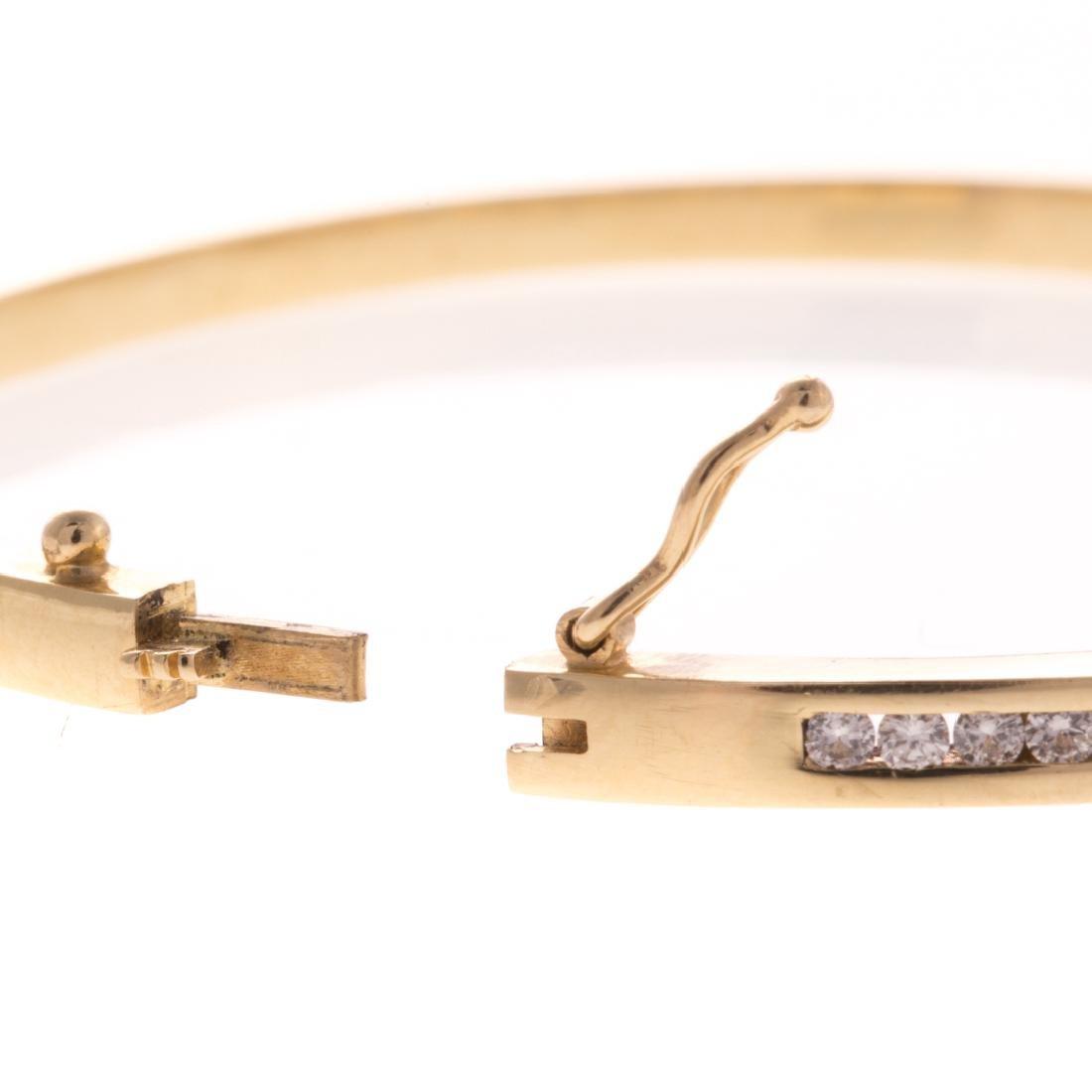 A Lady's Diamond Bangle Bracelet in 14K Gold - 4