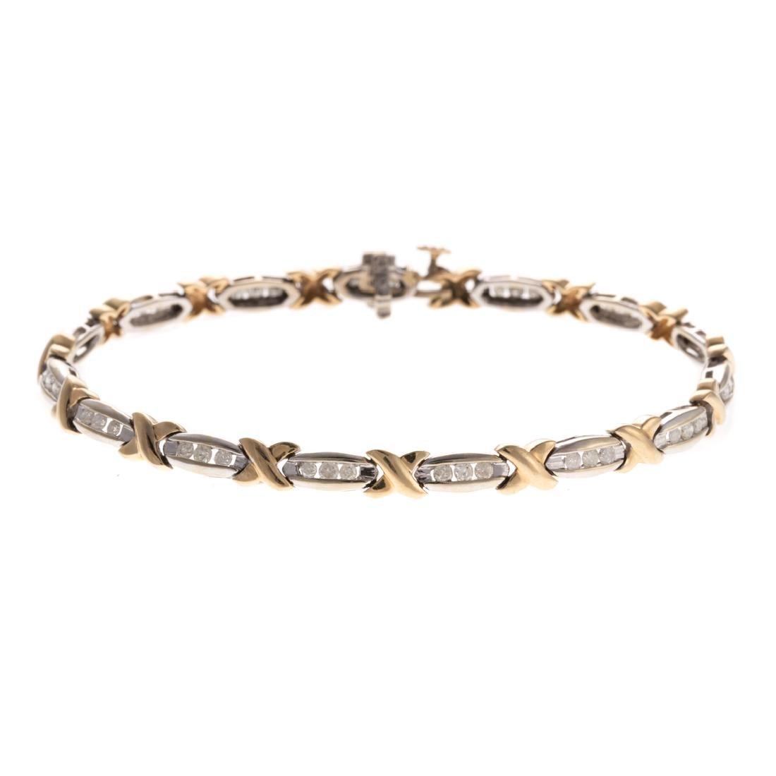 A Lady's Channel Set Diamond X Bracelet in 14K