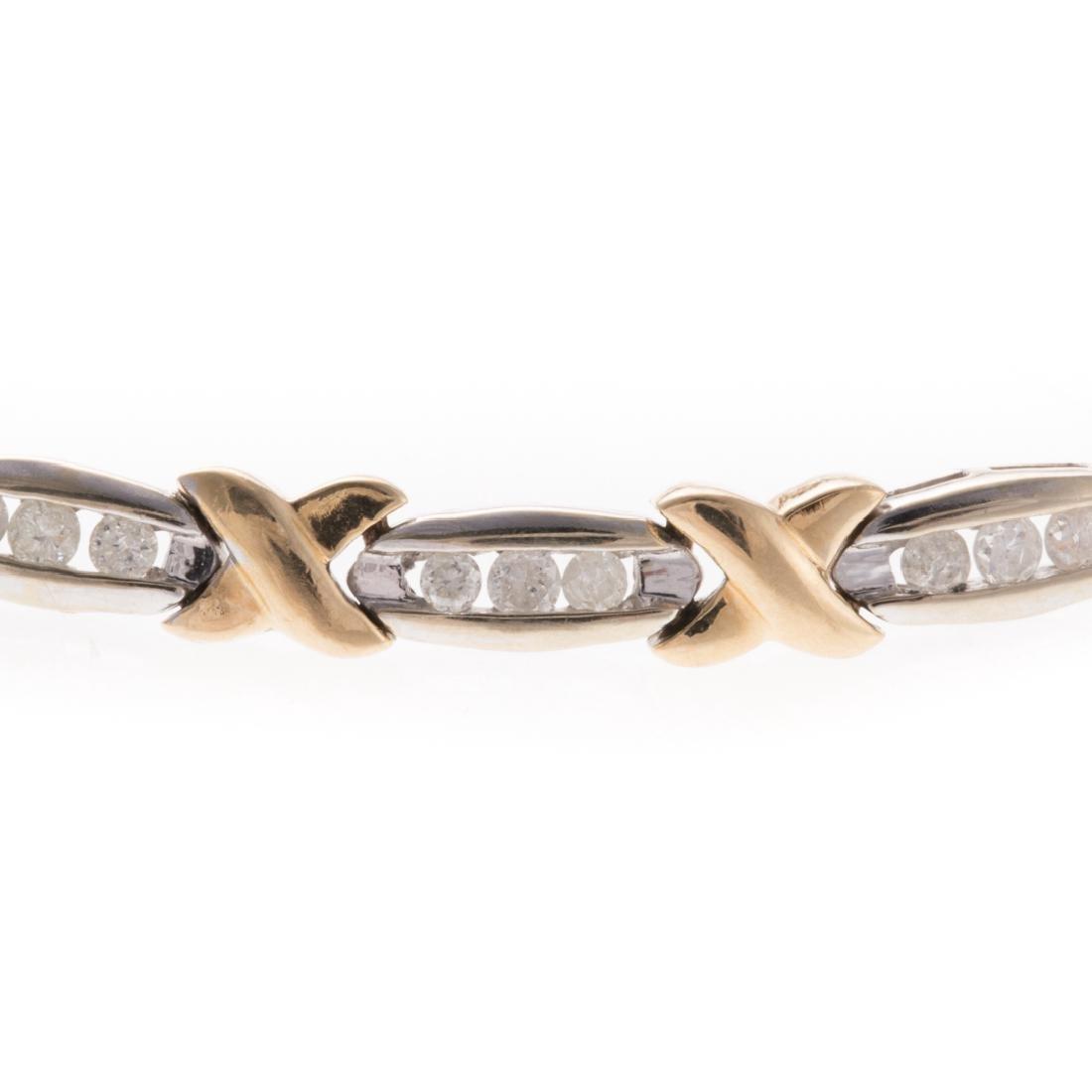 A Lady's Channel Set Diamond X Bracelet in 14K - 2