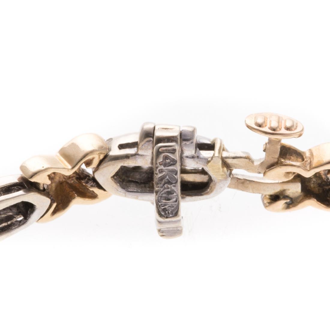 A Lady's Channel Set Diamond X Bracelet in 14K - 3