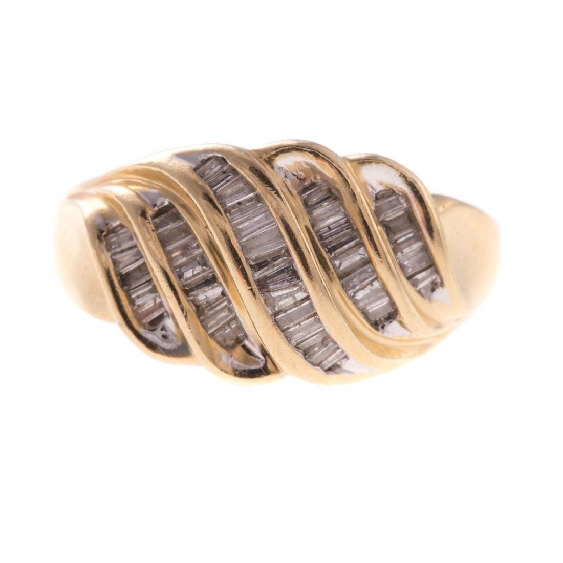 A Lady's Diamond Baguette Ring in 14K Gold
