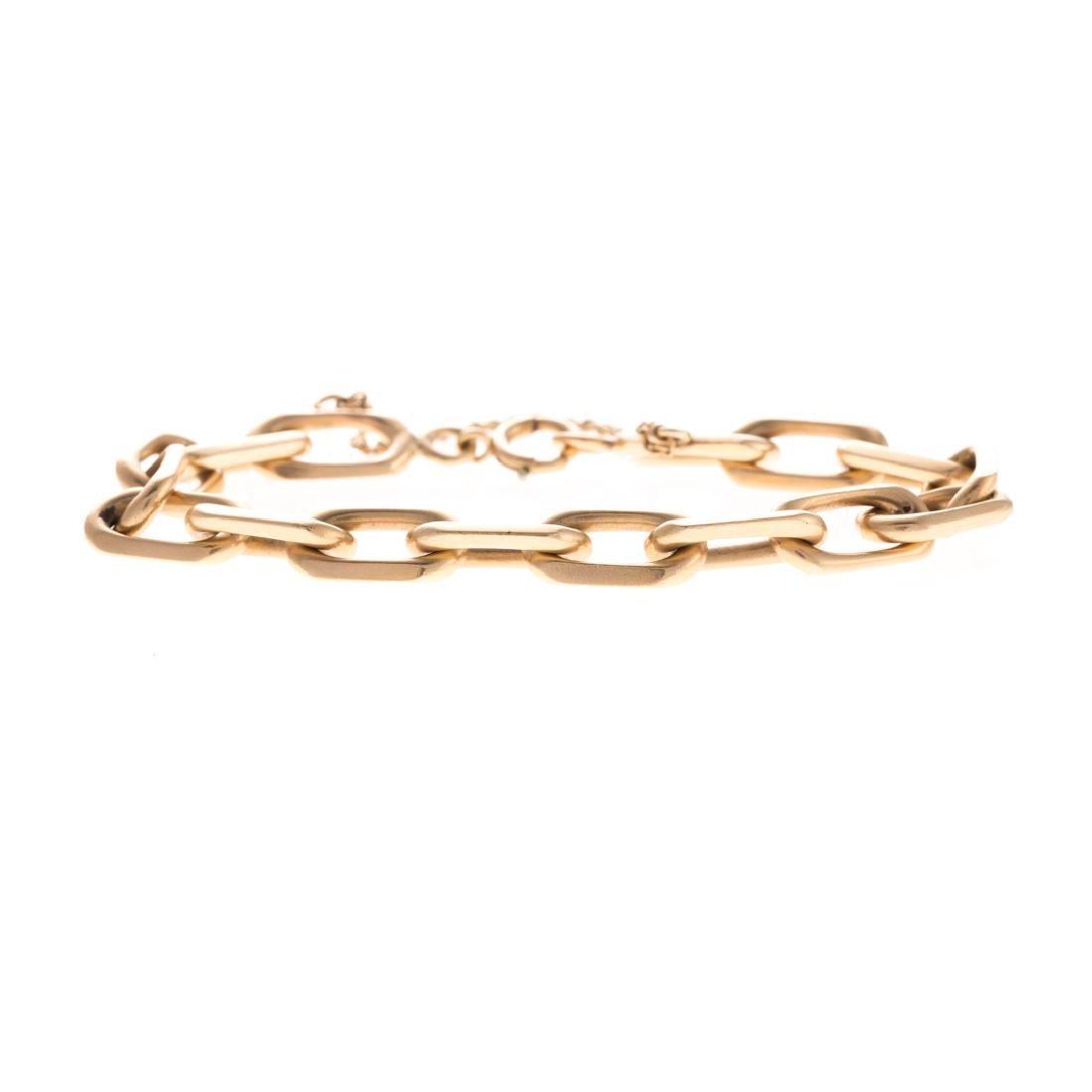 A Lady's Open Link Bracelet in 14K Gold