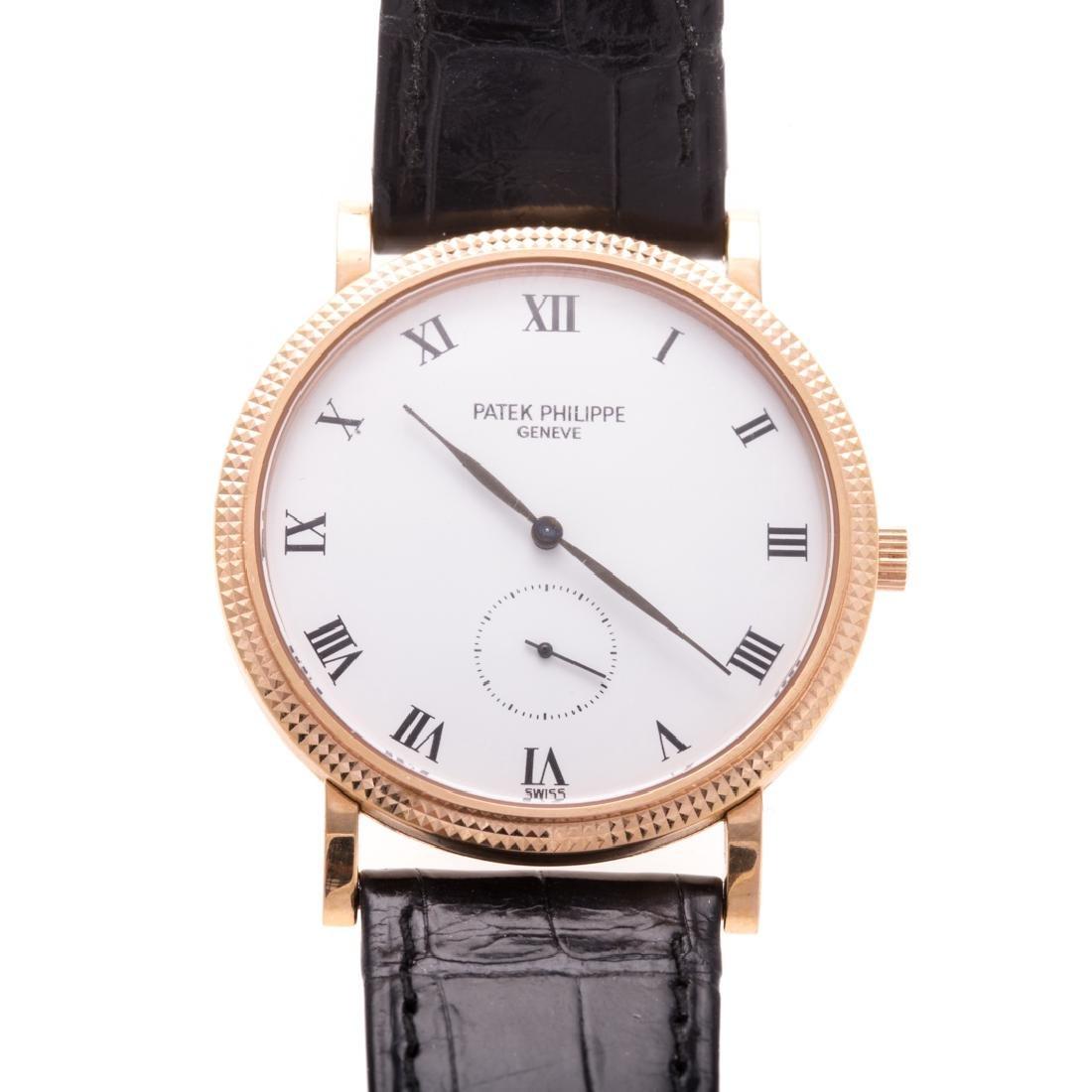 A Gentlemen's Patek Philippe Watch in 18K Gold
